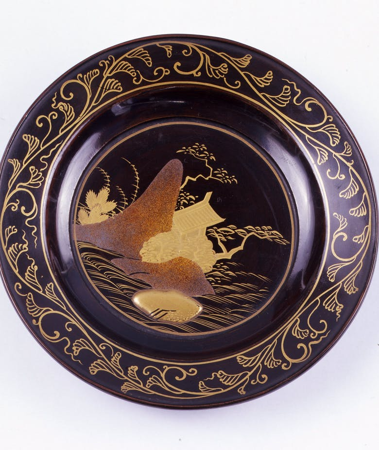 Japanese lacquered and painted plate featuring a river landscape with plants