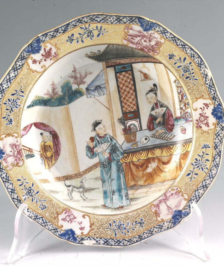 Chinese plate with three figures and a small dog