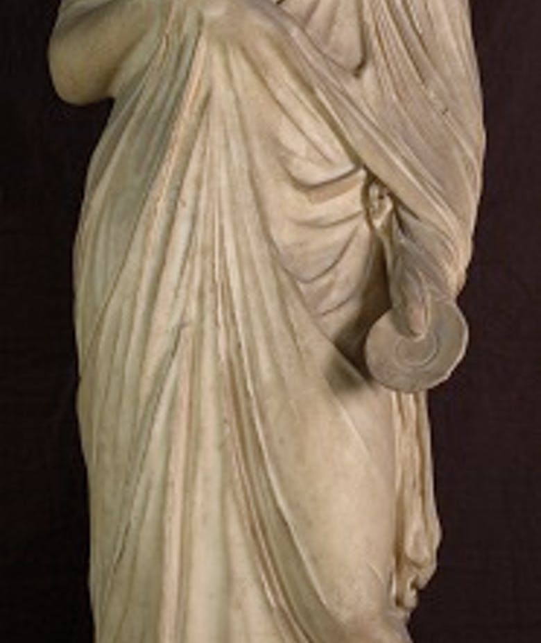 Female statue with ideal portrait